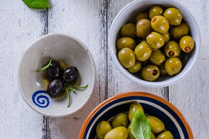 Green olives on a white plate