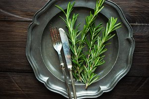 Table setting with rosemary