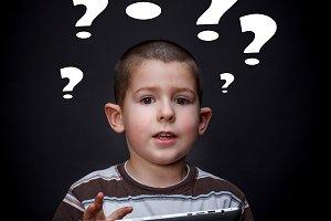 Boy with question mark symbols