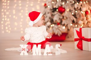 Happy baby over Christmas tree