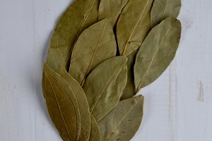 Bay leaf on the white wooden table