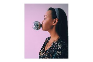 Woman blowing disco ball