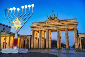 Brandenburg gate and hanukkah menorah