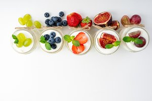 Yogurt with berries in glass jars