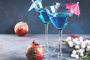 Blue cocktail in martini glass for Christmas party