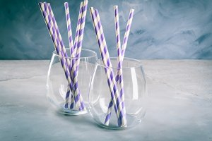 Empty drink glasses with party straws