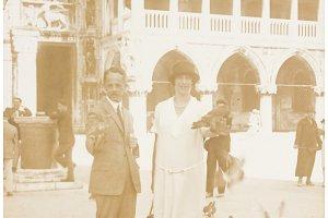 couple feeding pigieons on San Marco square, Venice