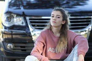 Teenager sitting on the floo