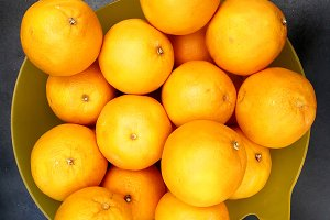 Oranges on plastic basket