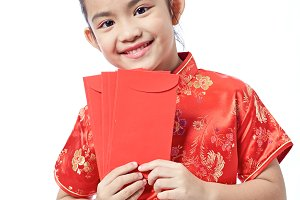 happy chinese new year. smile asian girl holding red envelope