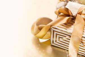 Closeup of golden gift horizontal