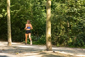 Woman running Vondelpark.