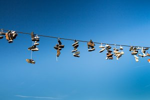 Shoes hanging on a cable