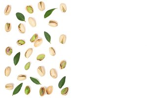 Pistachios isolated on white background with copy space for your text, top view. Flat lay pattern
