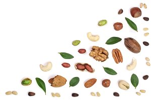 mix of different nuts with leaves isolated on white background with copy space for your text. Flat lay pattern. Top view