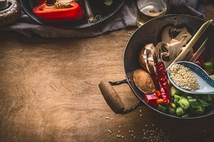Wok pot with asian cuisine ingredien