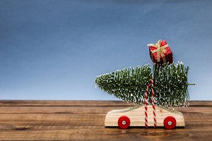 Wooden car with christmas tree