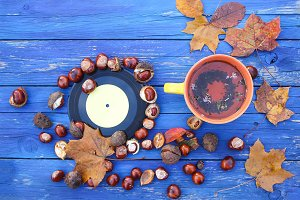 Cup of tea on autumn background