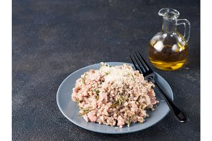 Raw buckwheat risotto with chicken meat and rosemary