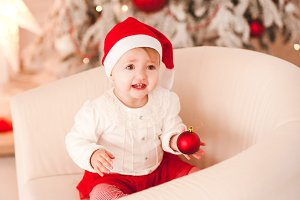 Laughing baby over Christmas tree