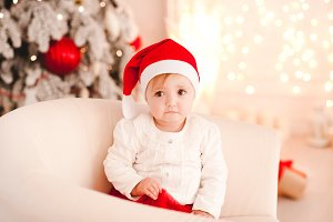 Sad baby over Christmas tree