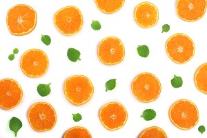 Slices of orange or tangerine with mint leaves isolated on white background. Flat lay, top view. Fruit composition