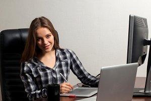 Retoucher works using laptop