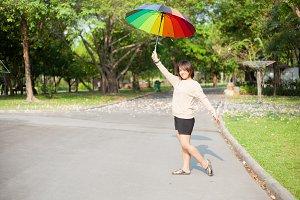 Women holding umbrella