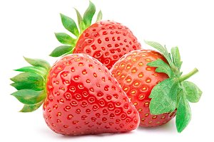 Three strawberries with leaves isolated