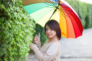 Asian woman holding an umbrella