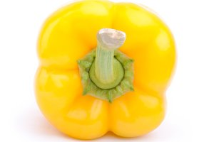 Back view of yellow pepper on the white background