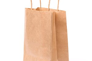 Paper shopping bag with handles isolated
