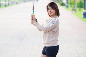Portrait Asian woman holding