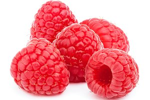 Five ripe raspberries isolated on white