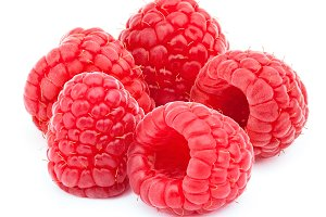 Five ripe raspberries isolated on
