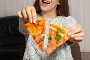 Woman with slices of pizza
