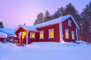Wooden cottage house in winter