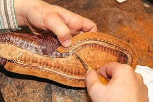 Repairing a brown leather shoe