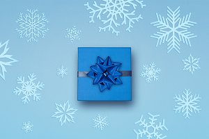gift with bow and snowflakes