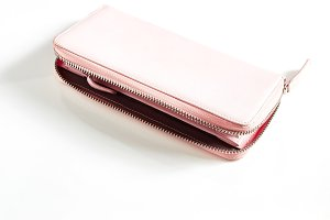 Woman pink purse isolated on the white background