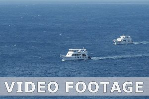 Powerboats and ship s sails along tropical sea