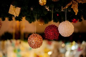 Beautiful decorated Christmas tree background with bauble and xmas ornaments blurred in bokeh home