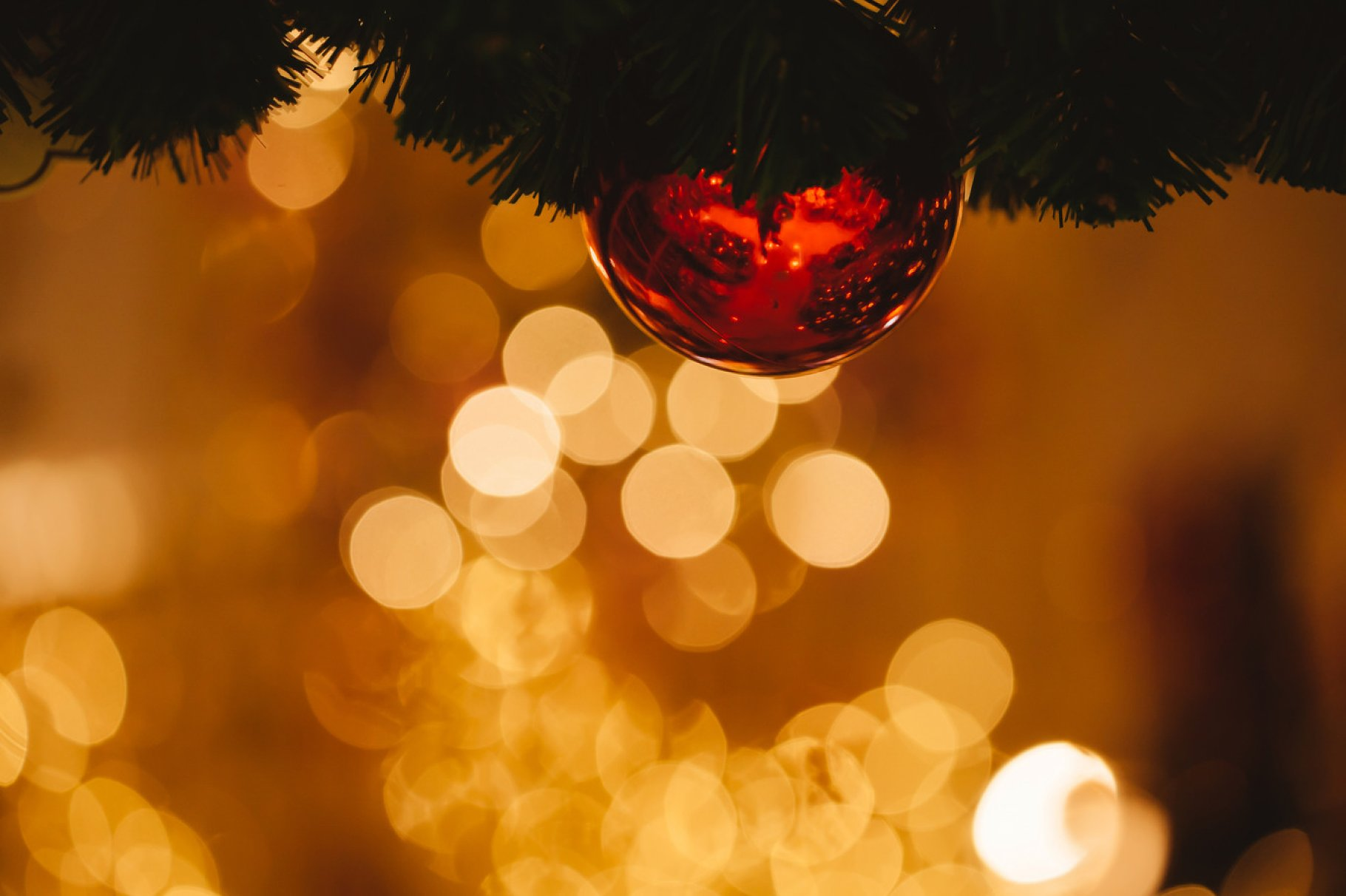 Christmas Ornaments Background.Beautiful Decorated Christmas Tree Background With Bauble And Xmas Ornaments Blurred In Gold Bokeh