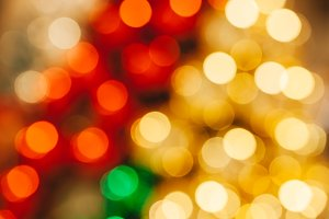Gold and red shiny abstract blurred bokeh used for holiday or Christmas background