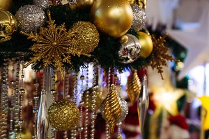 Christmas Baubles hanging with lighting stars in the background