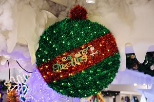 Seasons Greetings Text decorated on green red Christmas decoration tree ball