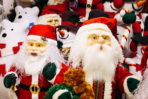 Horde of Santa Claus dolls and polar bears dolls on christmas background