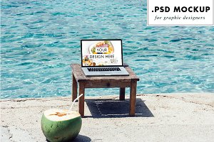 Laptop PSD mockup at the beach