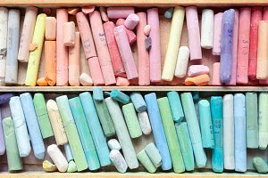 Pastel crayons in wooden box