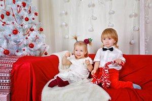 Brother and sister. Christmas tree